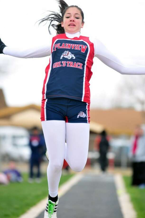Kevin Lewis/Plainview HeraldPlainview freshman Karli Wheeler tries to reach new heights — and lengths — during the long jump Friday at the Reagor-Dykes Bulldog Relays at Greg Sherwood Memorial Bulldog Stadium. (See story, Page 2B.)