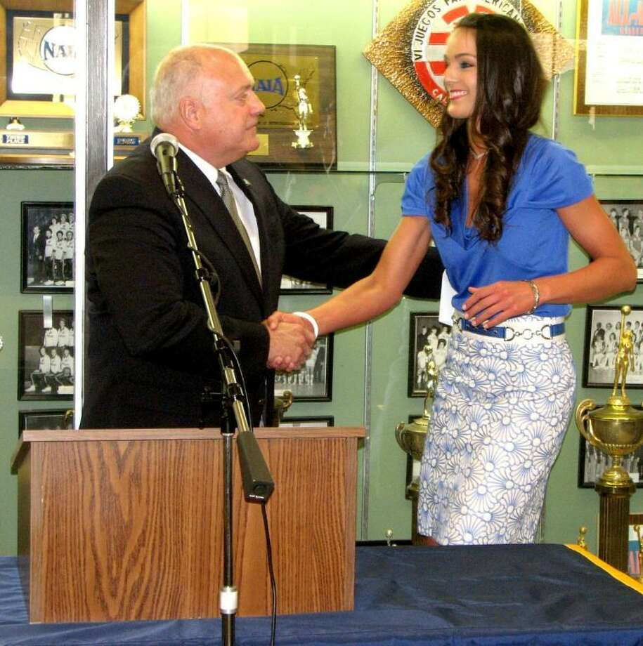 Wayland Baptist University Athletic Director Greg Feris welcomes new Flying Queens head coach Alesha Robertson to the program during a press conference at the Hutcherson Center Monday afternoon. Robertson, a former PHS Lady Dog and Texas Tech Lady Raider basketball all-star, was announced as the new coach last Monday, replacing former women's coach Tory Bryant. Photo: Kevin Lewis/Wayland Baptist Photo