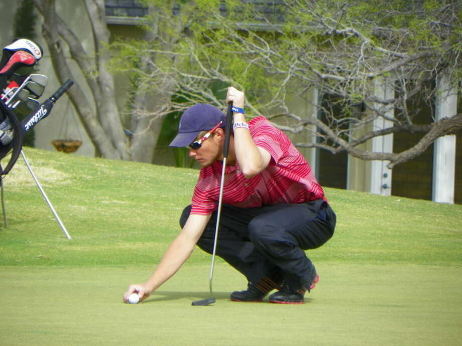 Bulldog Thomas Wirth gets ready to read the green during Thursday's 4-4A district championship, which opened its first round in San Angelo. Photo: Courtesy Photo