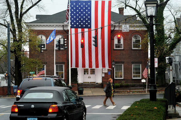 A large American flag hangs in front of Ridgefield Town Hall, at the intersection of Main St. and Bailey Ave. in Ridgefield, Conn. Nov. 12, 2015.
