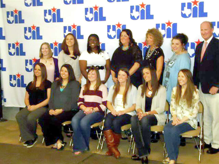 Members of the Plainview Lady Bulldogs who won the second of three straight Class 4A state championships from 2001-03 gathered in Austin two weeks ago during the girls state basketball tournament to be remembered for their accomplishment during the 2001-02 season. Pictured are (back, from left) trainer Michelle Craig, Chelsi Welch, Tojjinay Thompson, assistant coaches Rene Kayler, Mandy Steen and Amy Hagerman, and head coach Danny Wrenn; (front) Chelsea Hartman, Tiffany (Williams) Blackerby, Elyse Newland, Sarah Hauk, Alesha Robertson and Dana Reinart. The team defeated Dripping Springs 76-59 in the state semifinals before beating Dallas Lincoln in the finals 68-40. They finished with a 33-1 record.