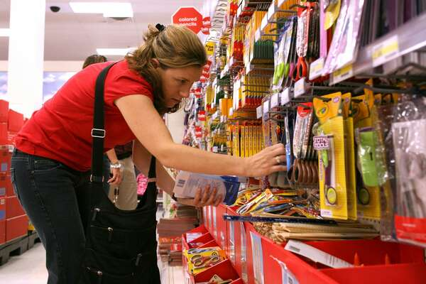 School teacher Liza Gleason shops for back to school supplies at a Target store August 13, 2008 in Daly City, California. With stores gearing up for back to school shopping, the Commerce Department reported today that retail sales fell 0.1 percent in July, the first time in five months.  (