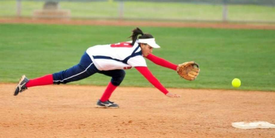 Plainview shortstop Averee DeLuna dives but can't reach a grounder in Tuesday's game against Frenship at Lady Bulldog Park. The Lady Tigers won 22-0. Photo: Kevin Lewis/Plainview Herald
