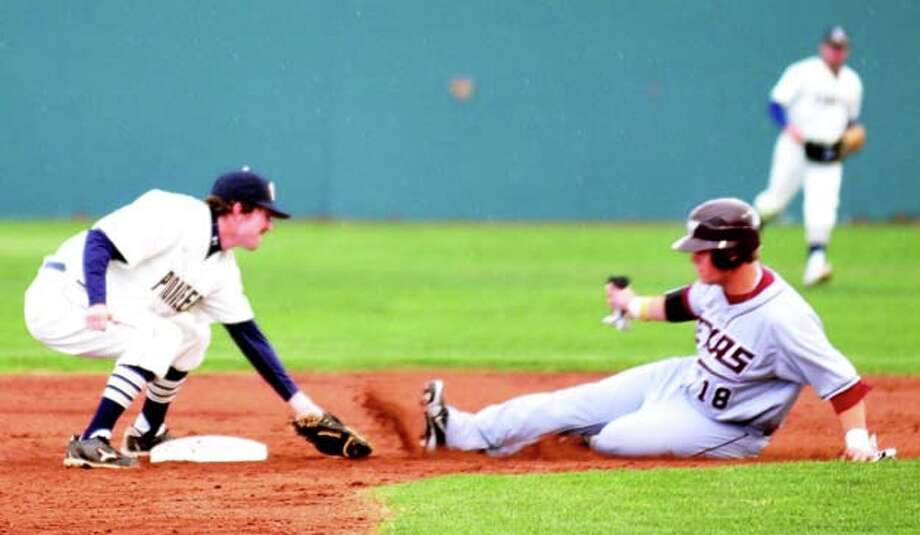 Wayland shortstop Chris Buitron easily tags out West Texas A&M baserunner Parker Wood on a failed steal attempt in Tuesday's game at Wilder Field. The Buffaloes won 11-4. Photo: Kevin Lewis/Plainview Herald