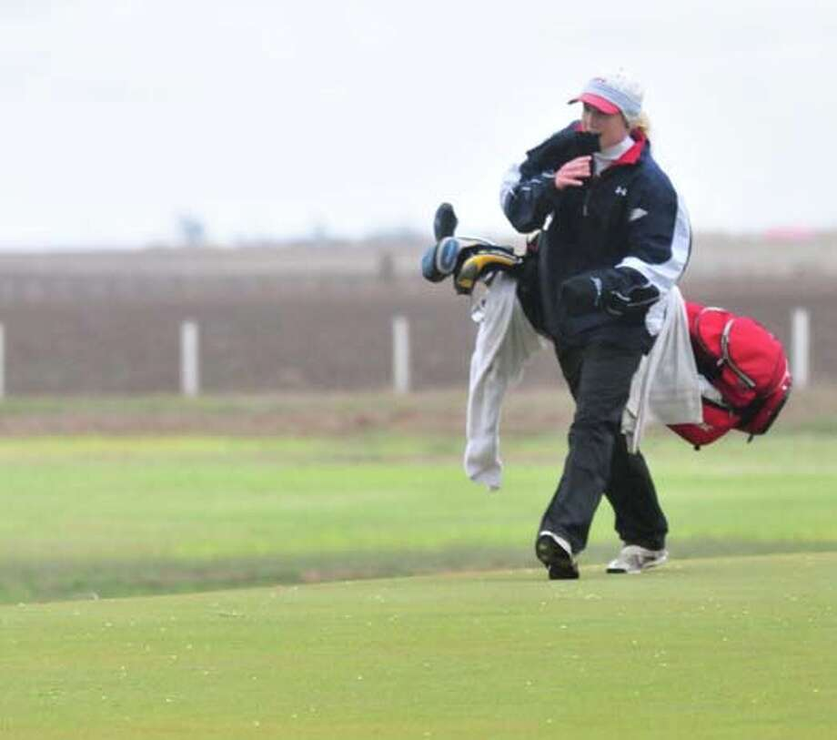 Plainview's Caroline Kinkaid attempts to stay warm as she plays in Wednesday's District 3-4A round at Plainview Municipal Golf Course. Photo:  Summer Morgan/Plainview Herald
