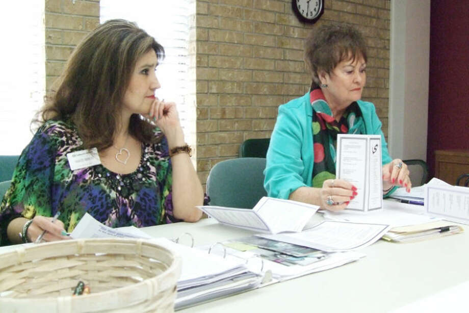 Financial Empowerment Center of the Plains board member Frances Barrera of Centennial Bank and Kay Harris, executive director of Crisis Center of the Plains, are seen at Thursday's board meeting. The group was discussing how they can get the word out for eligible applicants to apply for individual development accounts, or IDAs, which are matching savings funds designed to assist adults with financial literacy. Photo: Shanna Sissom/Plainview Herald