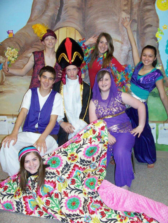 "Members of Plainview Christian Academy's seventh and eighth grade choirs enthusiastically prepare for a special production of ""Aladdin"" which will take center stage at the Fair Theatre in downtown Plainview on April 12. Principal players include (back row, left to right) Trip Fortenberry, Lauren Landtroop, Micah Martinez, (center row, left to right) Caleb Craig, Grip Fortenberry, and Kamri Knippa, with Lauren Pritchard as the magic carpet. Photo: Courtesy Photo"