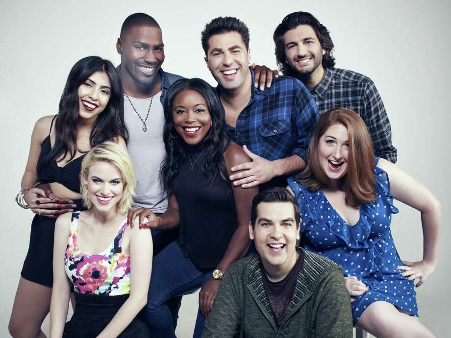 """The cast of The CW's new """"MADtv"""" features, clockwise from front left, Carlie Craig, Michelle Ortiz, Jeremy D. Howard, Lyric Lewis, Adam Ray, Amir K., Chelsea Davison and Piotr Michael. Photo: Tommy Garcia/The CW, HO / TNS"""