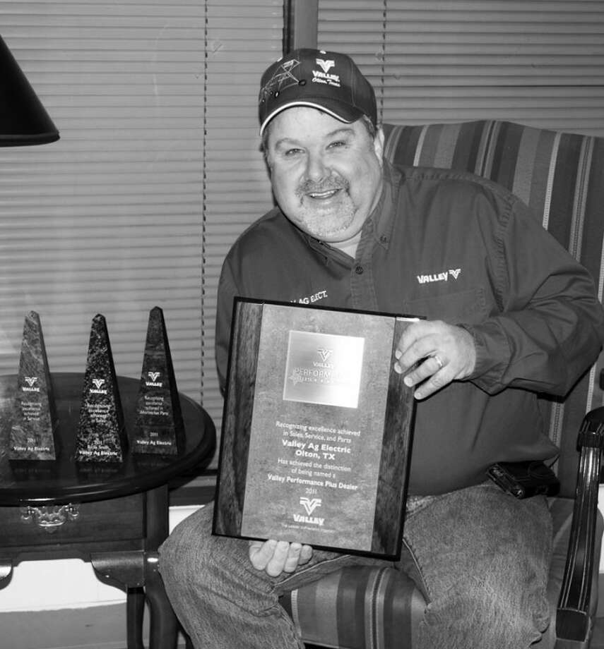 Phillip L. Hamilton/The EnterpriseRicky Smith, owner of Valley Ag Electric, holds the eighth Performance Plus Dealer Award the company has received. Beside him are three Excellence Awards presented to Smith and Valley Ag Electric at Valmont's 2012 National Meeting. Valley Ag Electric was one of only two dealerships to receive the Performance Plus Dealer Award as well as all three Excellence Awards.