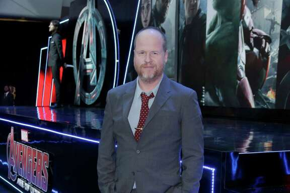 Director Joss Whedon poses for photographers upon arrival at the premiere for the film 'The Avengers Age of Ultron' in London, Tuesday, 21 April, 2015. (Photo by Joel Ryan/Invision/AP)