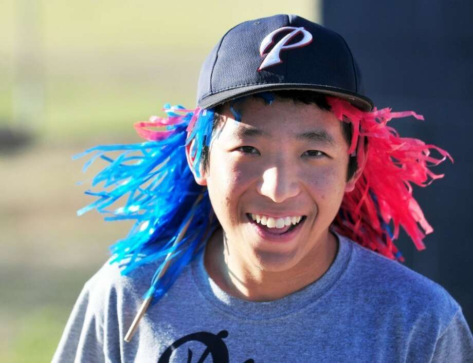 Jason Kang, a sophomore exchange student from South Korea, wears red and blue pom-poms in his hair during Plainview's baseball game Friday against Hereford at Bulldog Park. Kang is staying with Rocky and Donette Sabins.