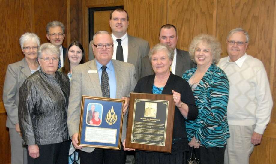 Dr. Otto B. Schacht and his wife Madonna display a plaque and shadow box recognizing an endowed scholarship in their name. Schacht is the dean of the School of Business. He and Madonna felt it necessary to endow a scholarship in part to perpetuate the mission of Wayland Baptist University. The couple is joined by friends and family, including their sons, Otto Jackie-Don Schacht and Byron Fritz-Nelson Schacht. The scholarship will benefit business students. Photo: Wayland Baptist University Photo