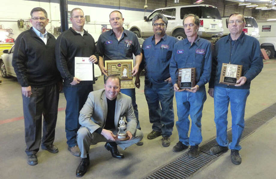 Courtesy PhotoFour technicians at Reagor-Dykes Ford-Lincoln-Toyota recently received Ford Motor Company Masters Awards designations. Shown with owner Bart Reagor (front) and fixed operations director Paul Chenoweth (left) are: Aaron Blackerby, service manager; Ray Johnston, 10-year Senior Master Technician; John Leija, Master Technician Gas Engines; Ronnie Cook, Master Technician; and David Andrae, Master Technician Gas Engines. Johnston, Leija, Cook and Andrae have more than 120 years combined experience, with Andrea having 40 years at the local dealership. Johnston is one of 30 technicians in the select dealer region to achieve 10-year Senior Master Technician.