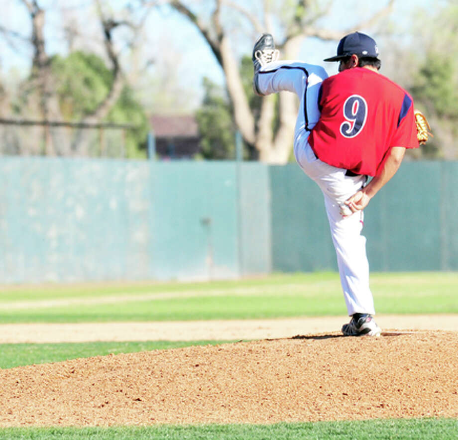 Plainview pitcher Jordan Vera and his unusual windup helped the Dogs to a 13-1 victory over Hereford on Friday at Bulldog Park. The Dogs next play at Palo Duro on Tuesday then host Frenship on Friday. Photo: Kevin Lewis/Plainview Herald