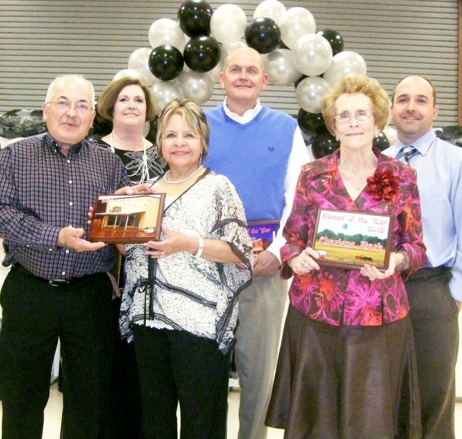 Honorees at the 2012 Tulia Chamber of Commerce Banquet on Thursday included (front, from left) Richard and Yolanda Villegas for Business of the Year; Woman of the Year Charlene Stark; (back) Jeannette Herring, who received an award in honor of her late husband John for his 35 years of service on the Tule Creek Soil and Water Conservation District Board; Man of the Year Rusty Gray; and Aaron Smith, Hustle for Tulia Award.  Photo: Kevin Lewis/Plainview Herald