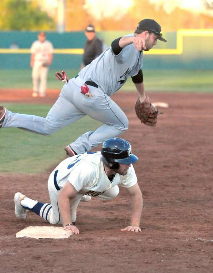 As Mid-America Christian first baseman Kevin Parsons jumps over him, Wayland's Ben Christian prepares to get to his feet after an errant pickoff attempt during Friday night's game at Wilder Field. Photo: Kevin Lewis/Plainview Herald