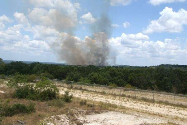 Crews were fighting a brush fire of at least 15 acres on Camp Bullis on Monday but no homes or military infrastructure was in danger, Army officials said.