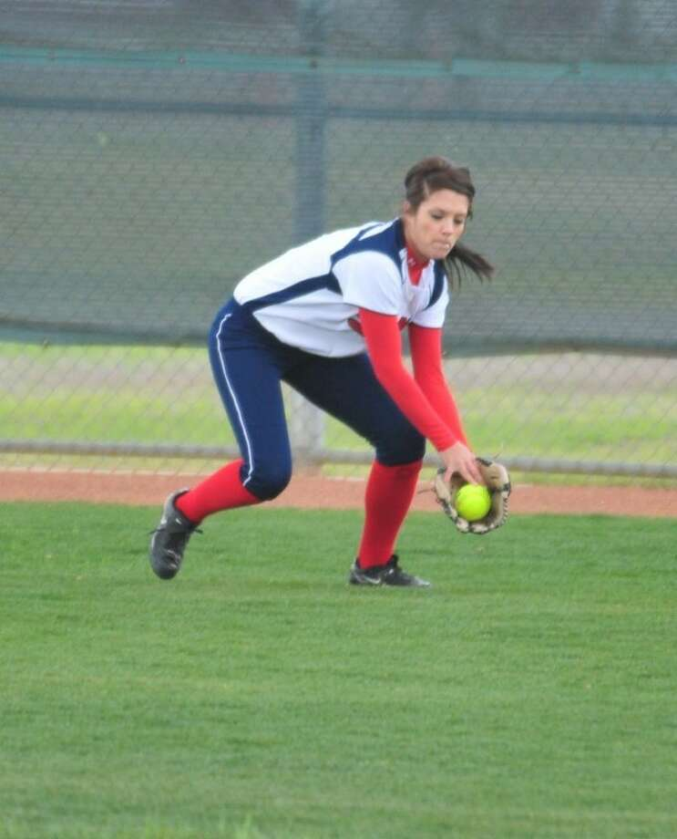 Plainview center fielder Kelsee Mora collects a ball during a recent game at Lady Bulldog Park. Photo: Kevin Lewis/Plainview Herald