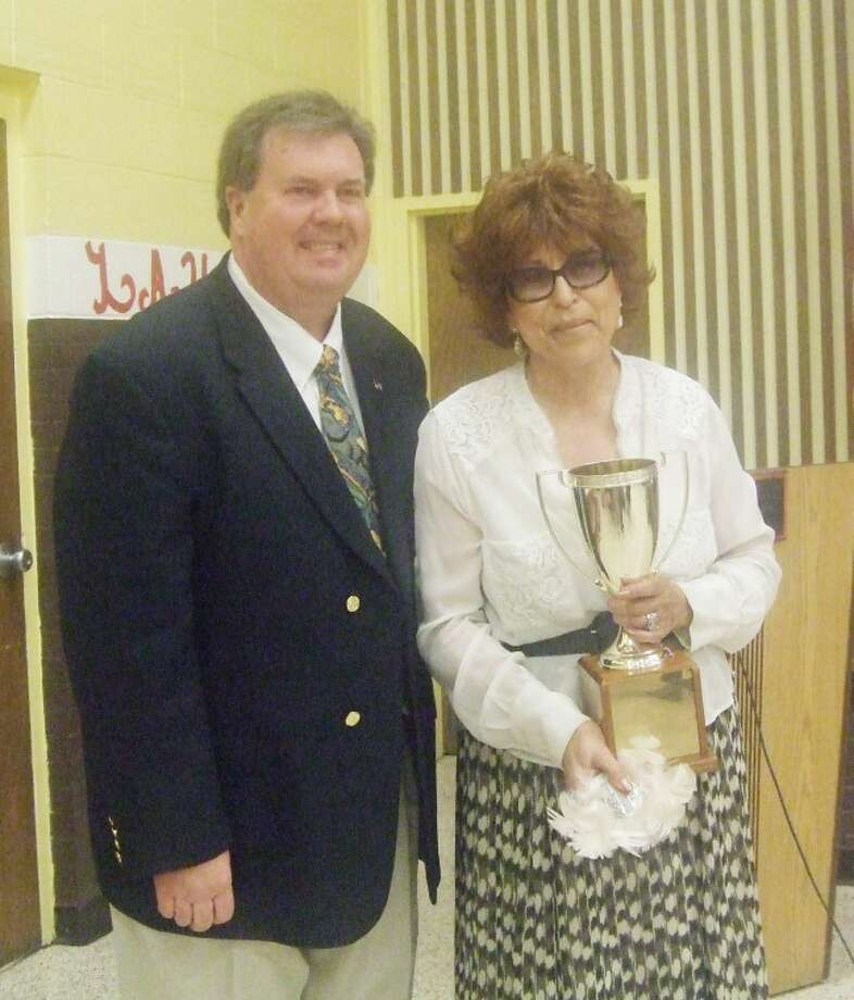 Jessica Thornton/Plainview HeraldBrent Barker (left) stands with 2011 Lockney Citizen of the Year Elsa Cooper at the Lockney Chamber of Commerce Banquet on Saturday night.