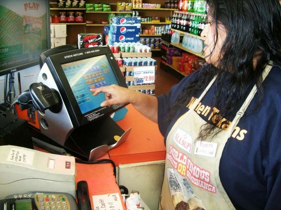 Kevin Lewis/Plainview HeraldChristina Riojas operates the lottery ticket printing machine at Allsup's at Fifth and Date. With $363 million up for grabs in Tuesday's Mega Millions drawing, lottery ticket sales have been brisk.