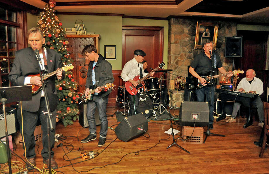 The Bad Slugs perform at the newsroon Christmas Party at the Crafty Monk on Friday, Dec 18, 2015. Ken Dixon, Mike DeSalvo, John Alcott, Pat Quinn, Ralph Hohman, Mike Daly. Photo: Cathy Zuraw, Hearst Connecticut Media / Connecticut Post