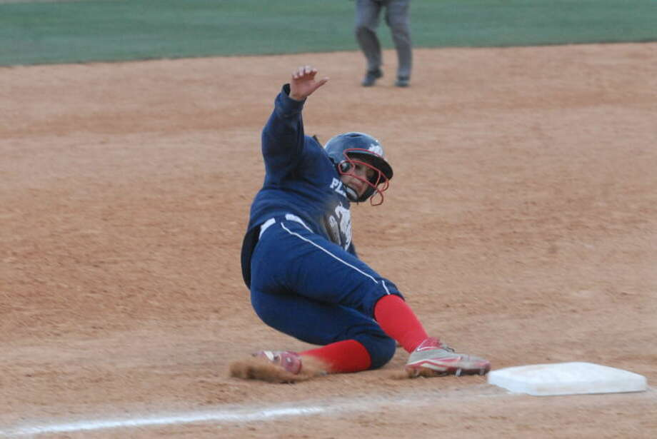 Lady Dog Averee DeLuna slides into third during Plainview's ball game with Lubbock High Tuesday evening. Photo: Homer Marquez/Plainview Herald