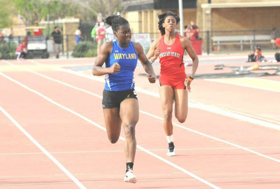 Wayland Baptist freshman Gortia Ferguson pushes hard at the line in the women's 200 meters at the Texas Tech Open on Saturday. Ferguson earned first place in the event with a 24.09. Photo: Summer Morgan/Wayland Baptist University