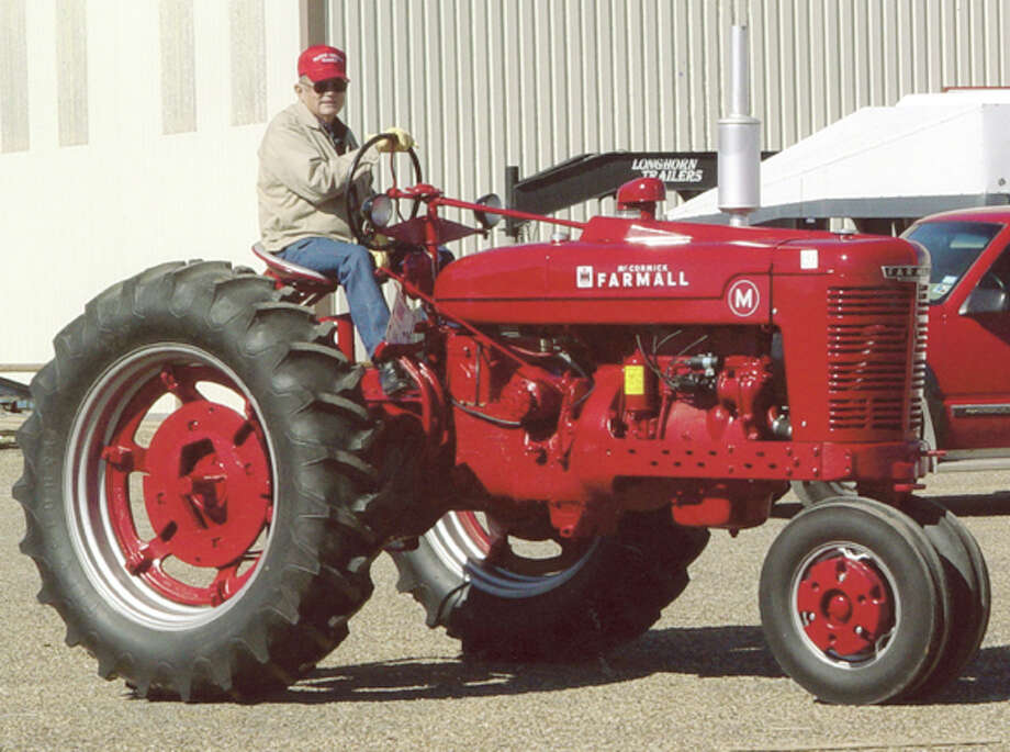 This year's 21st Annual Ollie Liner Antique Tractor Show on April 19-20 is dedicated to John Davey of Plainview, shown driving a Farmall tractor in an earlier show. Davey died last November.