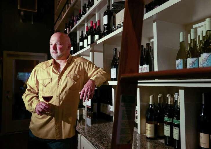 Scott Miller poses for a portrait with a bottle of 2014 Big Table Farm, Pinot Noir, Pelos Sandberg Vinyard, at Plonk Bistro, Wednesday, July 6, 2016, in Houston.  ( Jon Shapley / Houston Chronicle )