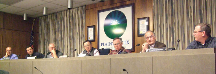 Planning and Zoning commissioners listen to citizens speak during a public hearing concerning the city's comprehensive plan Thursday. From left to right, are Jerry Rodriguez, Chris Lefevre, Mark Hardin, Chair Paul Drager, Danny Murphree, Paul Lyle and Kevin Sweeney. Photo: Shanna Sissom/Plainview Herald