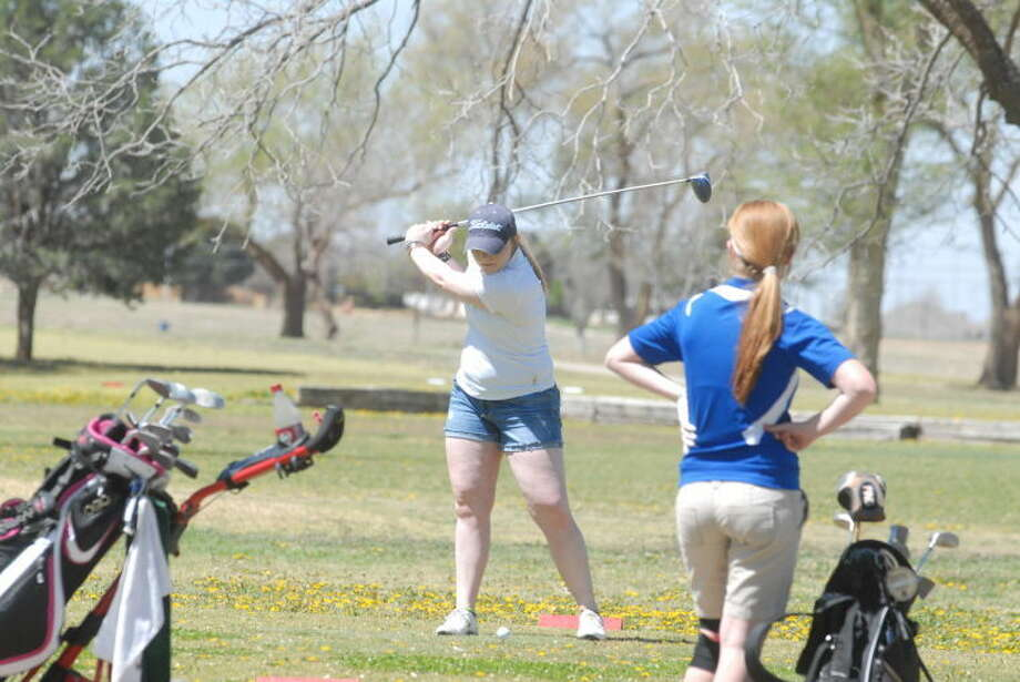 Lady Eagle Kayla Steffens drives a missile during Monday's TAPPS district/regional golf tournament at Plainview Municipal Golf Course. Steffens and both the boys and girls' teams qualified for the State championship on April 29 in Waco. Photo: Homer Marquez/Plainview Herald