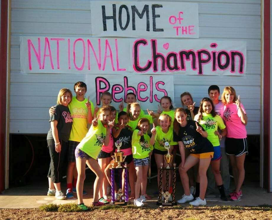 Members of Rebel Cheer and Dance celebrate after winning big at the Cheer World National Championship in Denton. Pictured above are coach Brandy Tirey, Garyson Tirey, Abby Hill, Austin Miller, Sawyer Tirey, Sissy Oldfield, Landon Cochran, Nora Quintanilla, Brooklyn Gilbreath, Maddy Hill, Caroline Northcut, Lexi Saenz, Kamryn Gregory, Sterling Hillyer, Adri Martin and coach Regina Boedeker. Not pictured is Madyson Lipcomb. Photo: Courtesy Photo