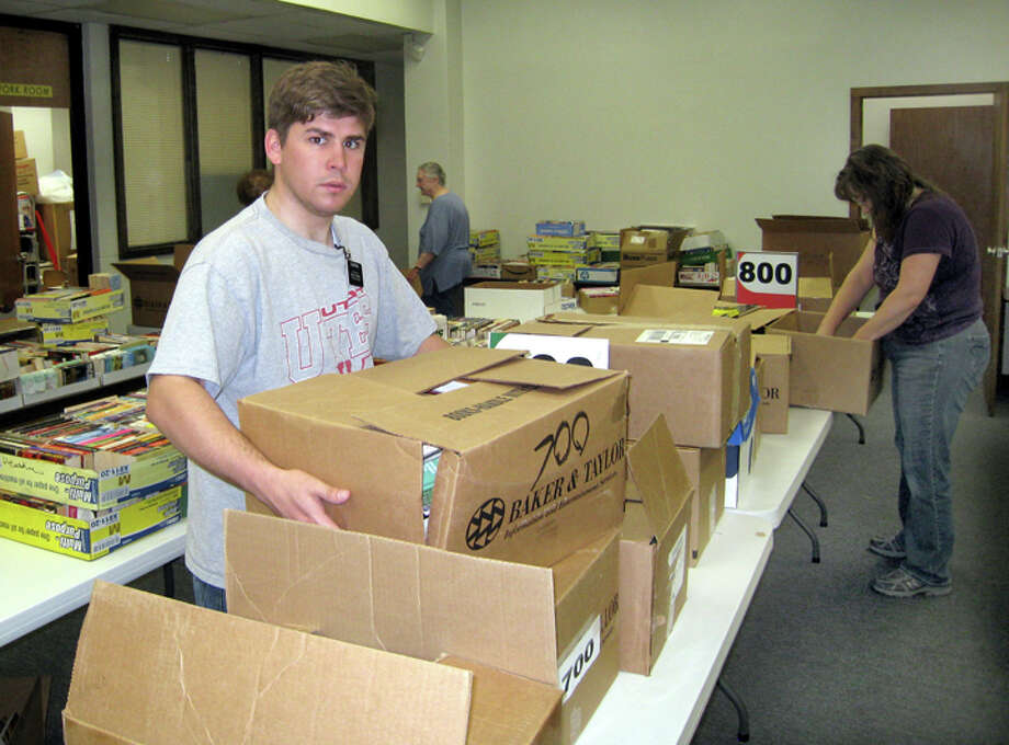John Sigwald/Unger LibraryWeston Reay, a missionary from the Church of Jesus Christ of Latter-day Saints, helps with the setup for the Friends of Unger Library's annual book sale from 2-6 p.m. Friday and 9 a.m.-4 p.m. Saturday. Thousands of paperback books (25 cents) and hardbacks (50 cents) will be available along with some multimedia, such as cassette tapes. Admission on Friday will require a Friends membership ($5 individual, $10 family), so come early for best picks. There is no admission charge on Saturday.