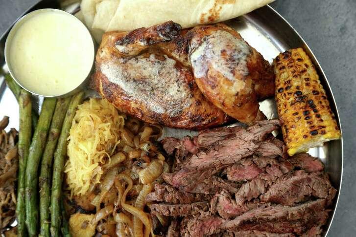 Chicken, beef and vegetable fajitas, and other sides, Fajitas A Go Go, Thursday, June 16, 2016, in Houston, Texas. ( Gary Coronado / Houston Chronicle )