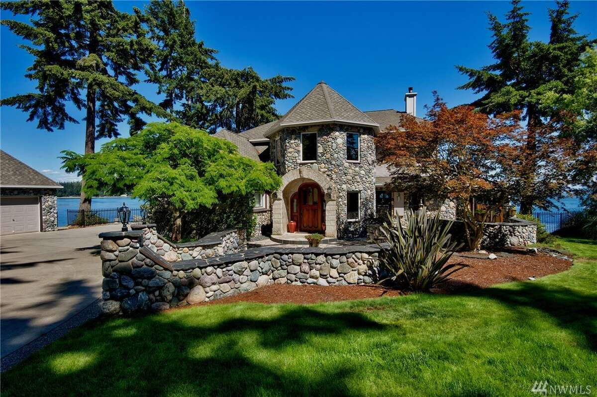 This Port Orchard home is listed for $1.411 million. The four bedroom, 3¼ bathroom home is a true island retreat. It has 215 feet of waterfront, unobstructed views of Mount Rainier, a 47-foot boat ramp and a three-hole putting green. You can see the full listing here.