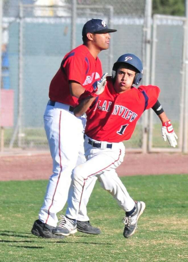 Plainview Bulldog Gus Licerio (1) rounds third base on his way to home plate while coach Hector Limon Jr. looks to an approaching baserunner during a recent game. The Dogs host Frenship at 5 p.m. today. Photo: Kevin Lewis/Plainview Herald