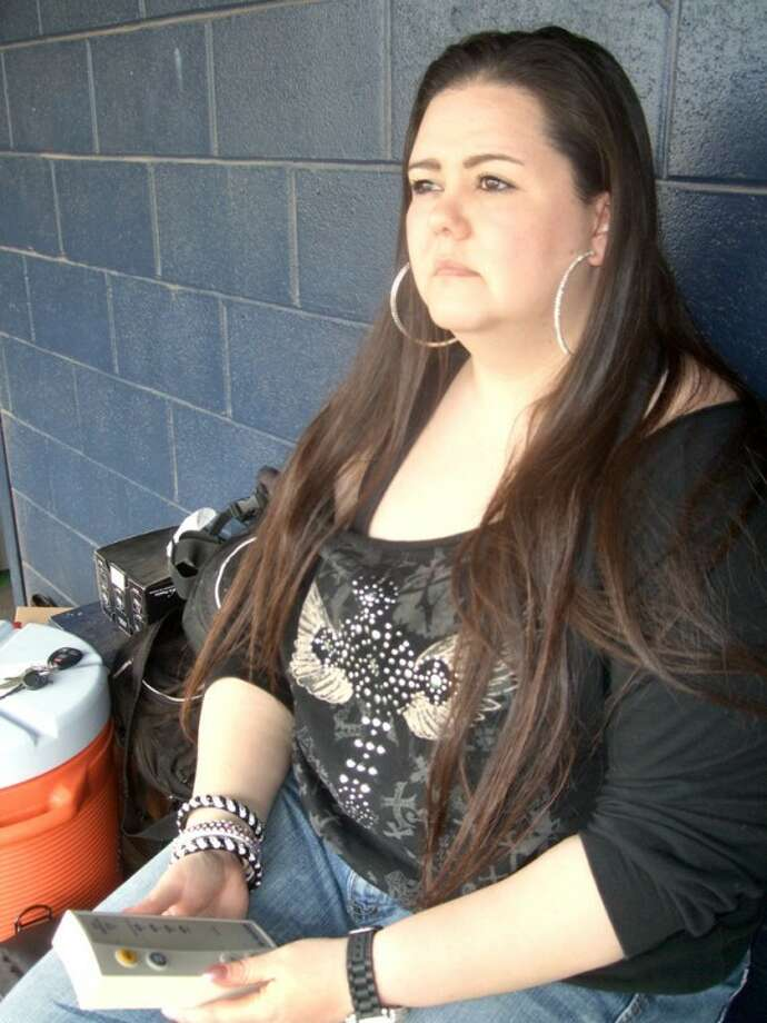 Plainview High School athletic trainer Valerie Duran uses a lightning detector to monitor conditions at a recent baseball game at Bulldog Park. Officials are required to suspend play when lightning gets within a certain distance. Play was not suspended during this particular game.