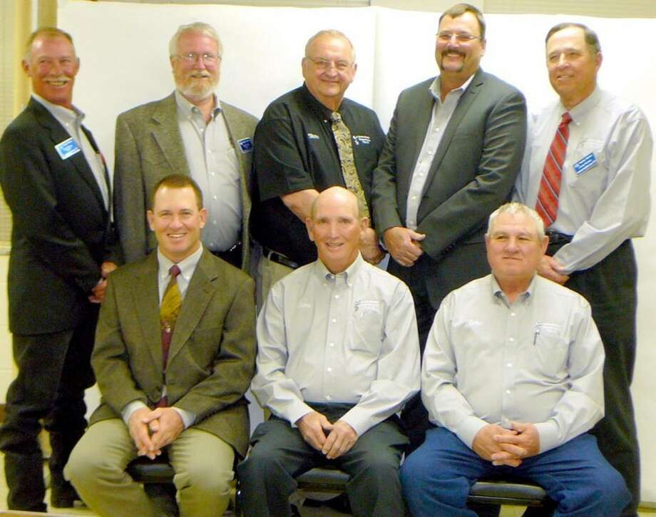 The Swisher Electric Cooperative Board of Directors includes (back, from left) Brad Sharp, Jimie Reed, Steve Gee, Dwain Strange, Jimmy Burson; (front) Mace Middleton, Gene Latham and Zeke Frost. Burson and Latham were re-elected to the board for 2012 during the group's annual meeting Thursday. Photo: Picasa