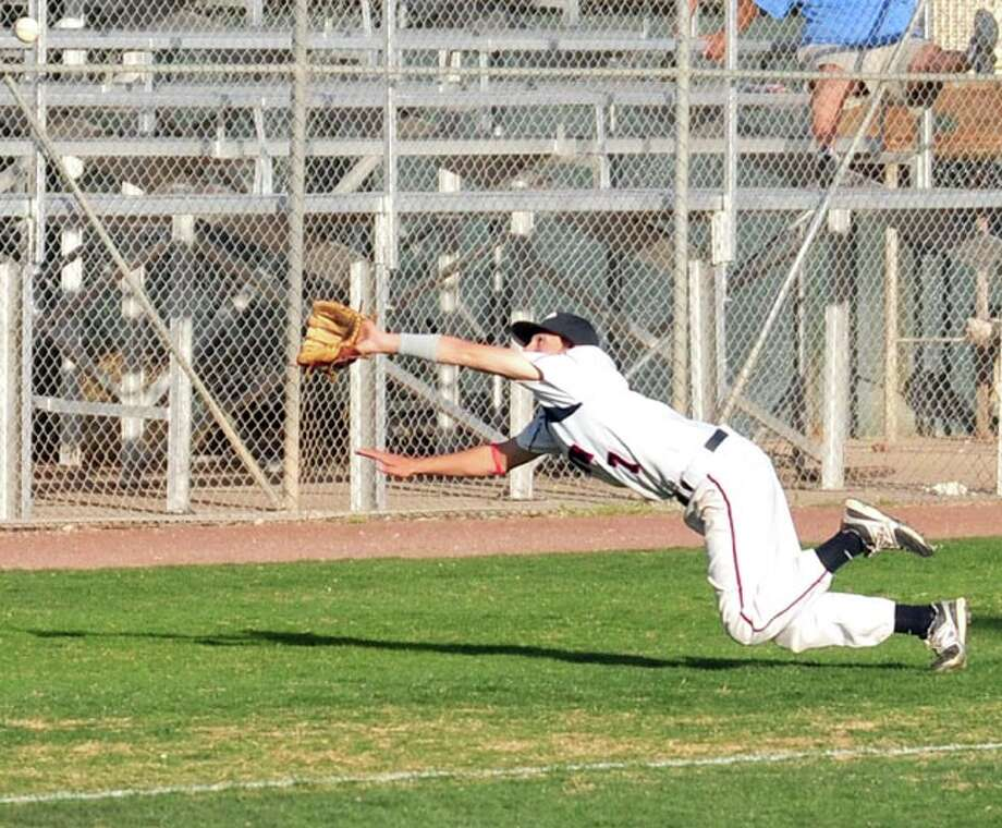 Plainview third baseman Trey Hernandez lays out in order to make a spectacular catch on a foul ball during Friday's game against Frenship at Bulldog Park. Left fielder Chance Rollins made a similar diving play one batter later. Photo: Kevin Lewis/Plainview Herald