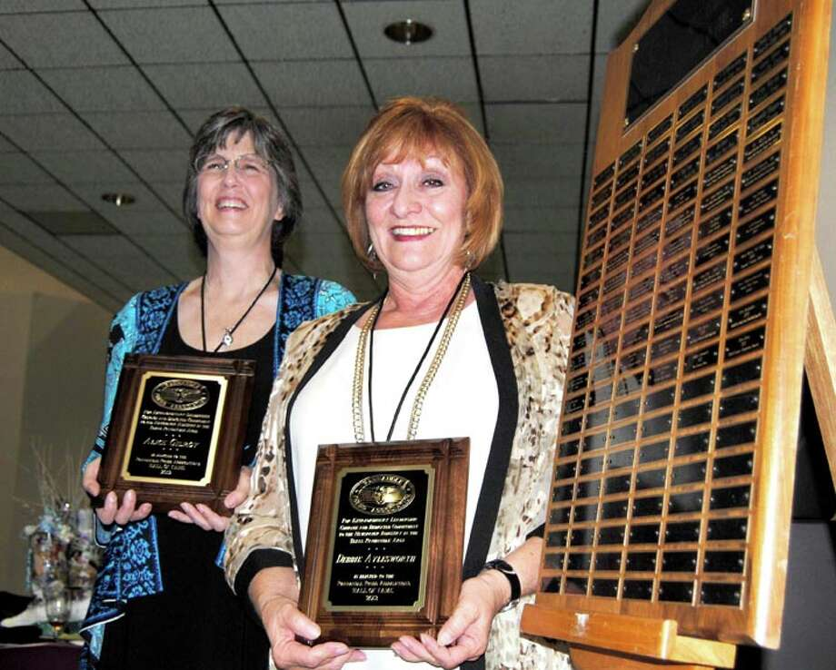 Alice Gilroy (left), former Floyd County Hesperian Beacon publisher; and Debbie Aylesworth, former Canyon News publisher, were inducted into the Panhandle Press Association's Hall of Fame during the group's 102nd annual convention in Canyon on Friday. Photo: Doug McDonough/Plainview Herald