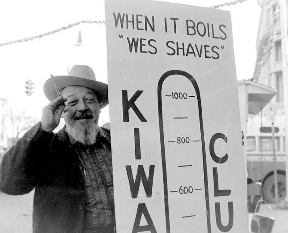 KVOP Radio personality Wes Carpenter, with straight razor in hand, poses beside a Plainview Kiwanis Club poster while offering to shave his familiar beard if the group raised $1,000 for the 1961 Christmas Cheer effort. Carpenter indeed shaved his whiskers after the club more than doubled its fundraising goal. Photo: Herald File Photos