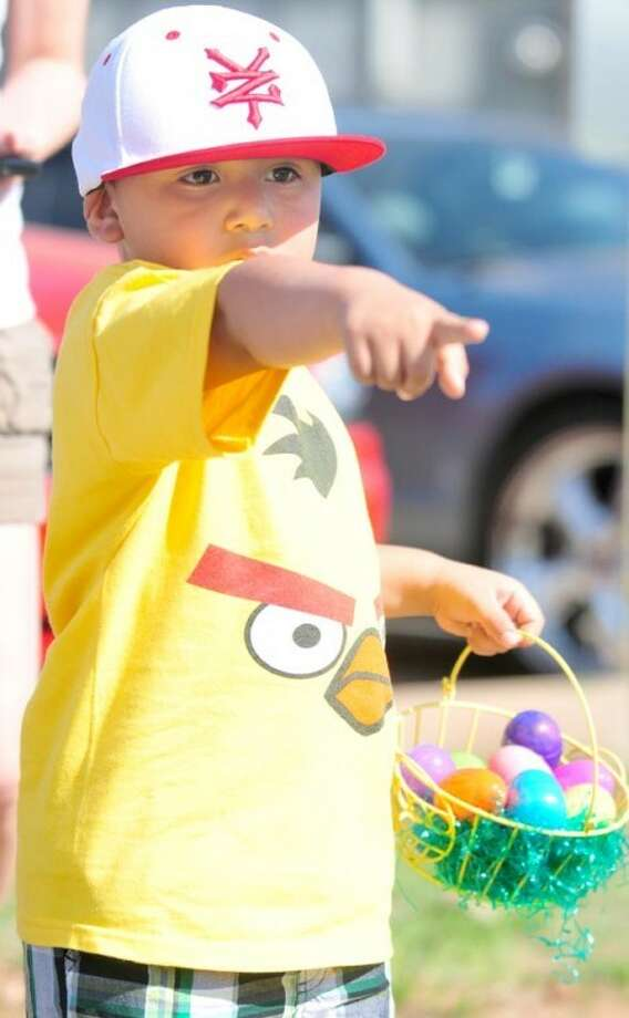 Zacchaeus Ortiz, 3-year-old son of Danny and Senaida Ortiz of Plainview, participates in an Easter egg hunt hosted Saturday at Covenant Hospital Plainview. Close to 100 kids hunted eggs and were treated to punch and cookies. Today is Palm Sunday, leading into Holy Week capped by Easter next Sunday.