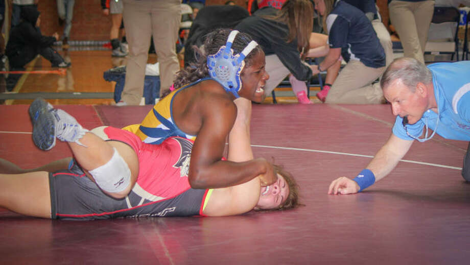 Courtesy Geri Bruggink. Not available for sale or republication.Wayland's Tamyra Mensah (top) was ranked No. 3 by USA Wrestling late last week and will be competing in the ASICS Las Vegas U.S. Open on Thursday. Photo: Geri Bruggink