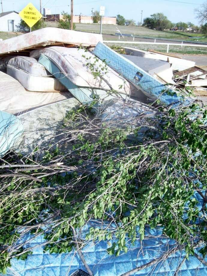 Despite signs against dumping tree limbs and dumping period, old mattresses and other unwanted items end up at the recycling site located at Second and Columbia. City officials are looking into purchasing a camera to help monitor the area so they can begin enforcing the law against illegal dumping. Photo: Kevin Lewis/Plainview Herald