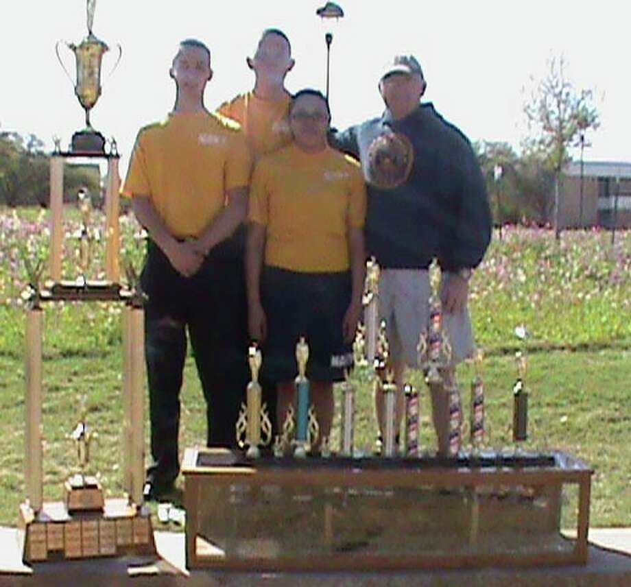 Courtesy PhotoShown with trophies won at the Angelo State University JROTC Invitational Drill Meet are PHS senior cadets David Bolding (left), Kalen Riley and Cheyenne Diaz, along with Senior Naval Science Instructor Chief Brad Brantley.