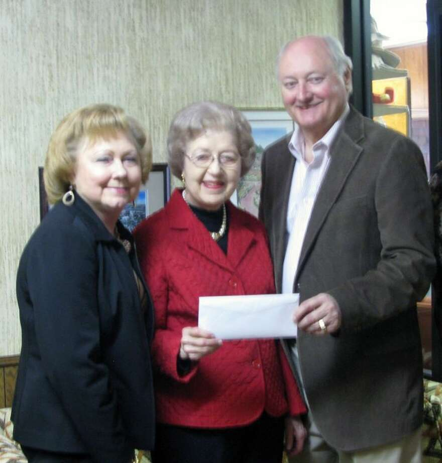John Tye, chairman the Plainview Area Endowment, presents a $15,000 check to Alice Sawayer (left), board member, and Jeannine Green, president of Plainview Community Concert Association. The grant will assist the group in securing quality performances during the coming season without having to increase the cost of membership. Photo: Courtesy Photo