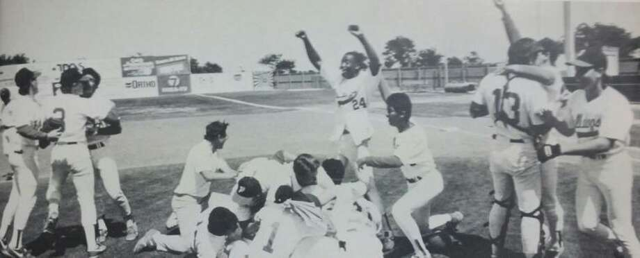 The 1988 Plainview Bulldog baseball team celebrates after winning the school's first bi-district championship. Photo: Courtsey Photo