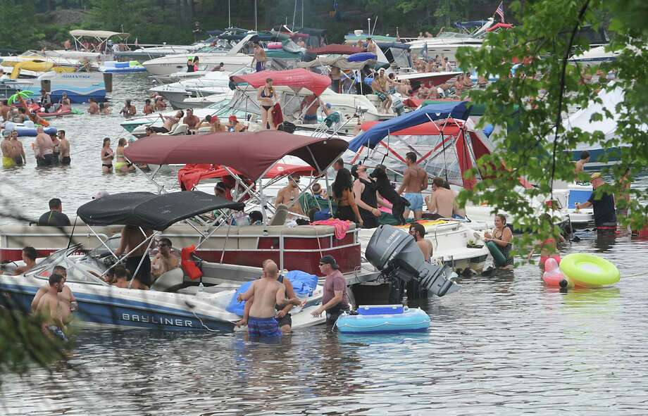 People enjoy the water during Log Bay Day, the annual party on the water on the east side of Lake George at Log Bay on Monday July 25, 2016 in Fort Ann, N.Y. (Lori Van Buren / Times Union) Photo: Lori Van Buren / 20037423A