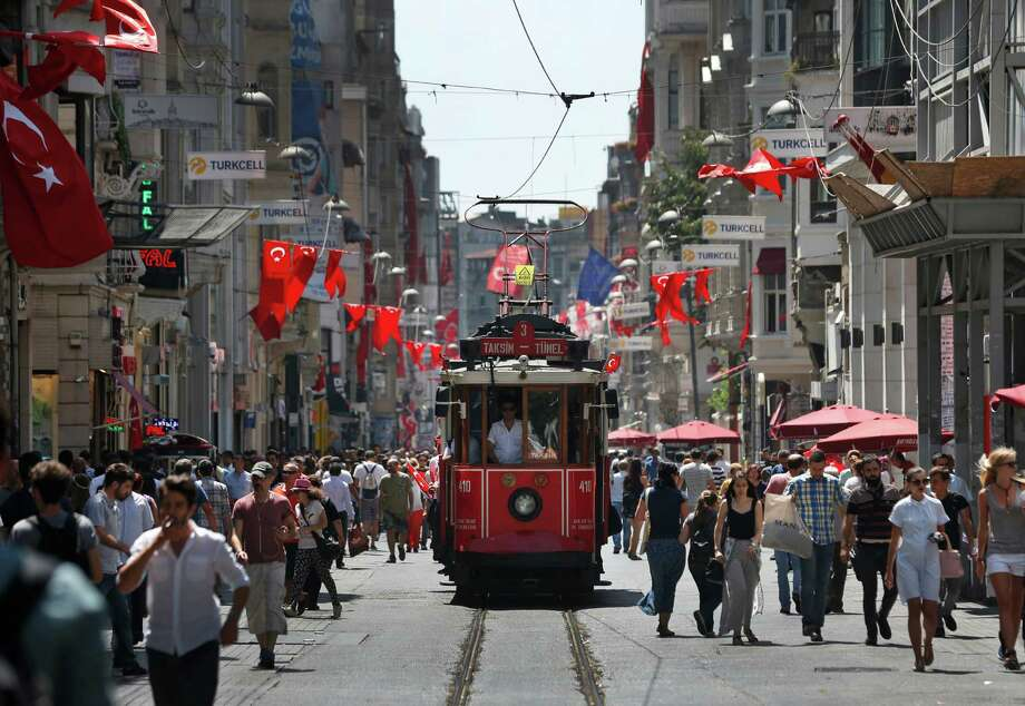 People walk in central Istanbul's Istiklal Avenue, the main shopping road of Istanbul, Monday, July 25, 2016. Turkish media said authorities have issued warrants for the detention of 42 journalists and detained 31 academics, as the government pressed ahead with a crackdown against people with allegedly linked to a U.S.-based Muslim cleric. (AP Photo/Lefteris Pitarakis) Photo: Lefteris Pitarakis, STF / Copyright 2016 The Associated Press. All rights reserved. This material may not be published, broadcast, rewritten or redistribu