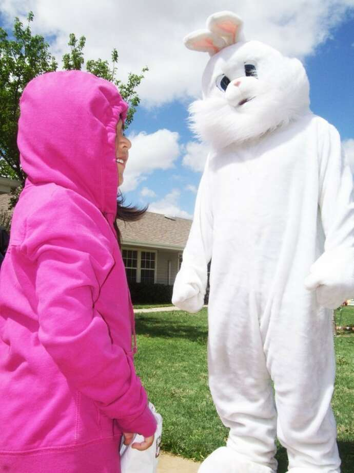Kevin Lewis/Plainview HeraldPre-kindergartners at La Mesa Elementary, including Beverly Garcia, got some egg hunting practice in when the Easter bunny visited Santa Fe House Assisted Living Center on Wednesday afternoon.